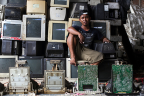 Electronic Waste Worker with Electronic Waste in Jombang