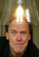 Portrait of Bert Visscher with Low Energy Light Bulb