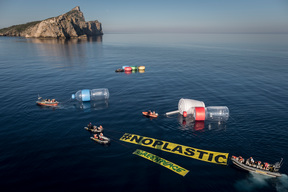 The Rainbow Warrior Invaded by Giant Plastic Packaging in the Med