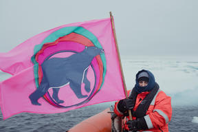 MY Esperanza Crew with Flag in the Arctic