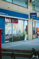 Volunteers Rebrand Tesco's Shop Windows in Shoreditch, London