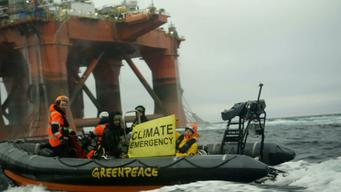 BP Oil Rig Protest in the North Sea - Day  8 - Climate Emergency banner held alongside BP rig_News Access