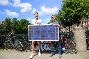 Amsterdam Citizens Holding a Solar Panel