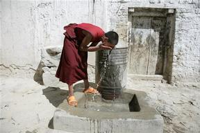 A Buddhist Monk Washes Himself