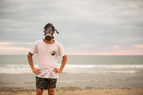 Surfer with Gas Mask in La Union