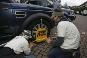 Greenpeace Volunteers Target Land Rover Forecourts